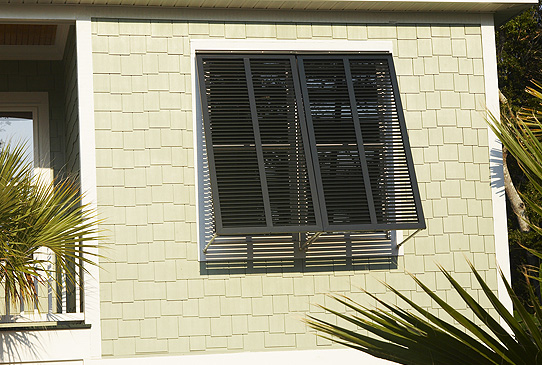 Bahama shutters exterior functional atlantic premium shutters architectural series for Exterior louvered window shutters